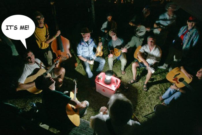 Bluegrass pickers jamming at night in a circle
